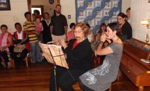 Julia playing a flute duet with her teacher Monoka Brown at her high school graduation celebration