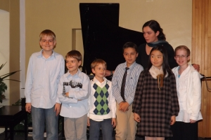 Julia and six out of eight of her piano and voice students this past year