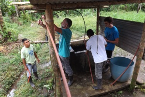 Ron and Isaac helping Ramon's family in Sinangue set up a water system for their house