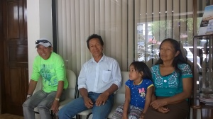 Ramon, Luciano, (grandchild), and Serafina waiting at the eye doctor's office